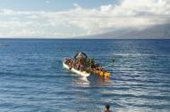 Santa nearing Maui by canoe