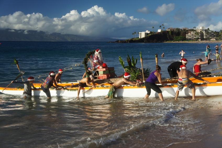 Santa makes landfall in Kaanapali Maui by canoe